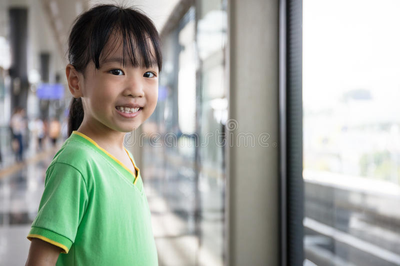 Asian Chinese little girl waiting for transit royalty free stock image