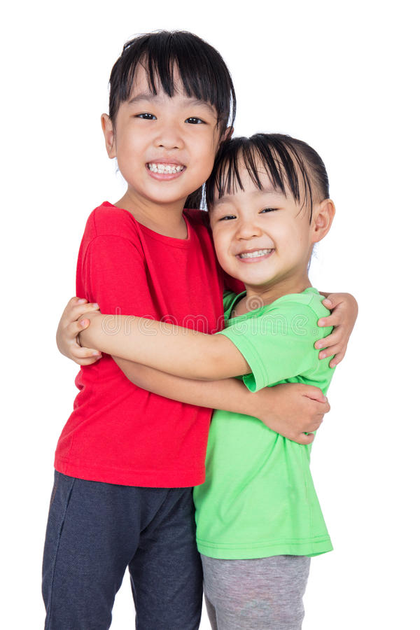 Asian Chinese little girls hugging each other stock photo