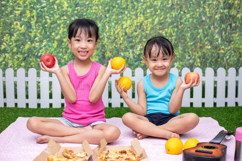 Asian Chinese little sisters having picnic stock photos