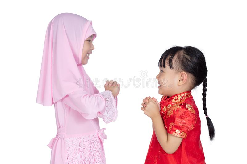 Asian Chinese little sisters wearing cheongsam and traditional M royalty free stock photo