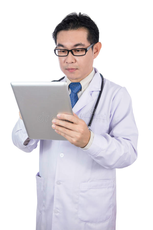 Asian Chinese male doctor holding a tablet royalty free stock photo