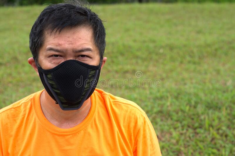 Asian Chinese Male with mask royalty free stock photo