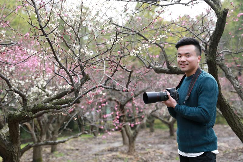 Asian chinese man photographer in nature stock photography
