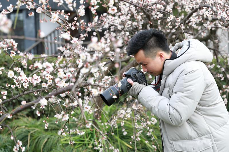 Asian chinese man photographer in nature royalty free stock photos