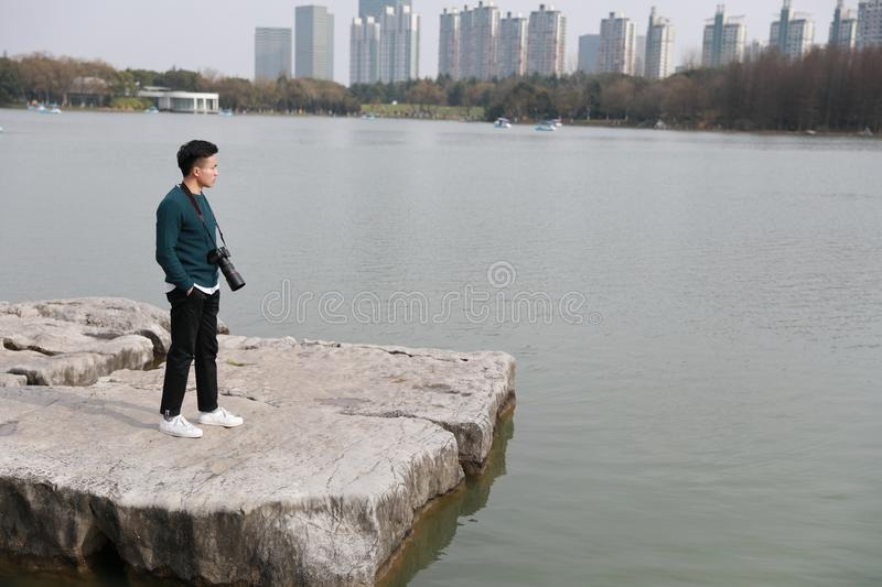 Asian chinese man photographer in park stock photo