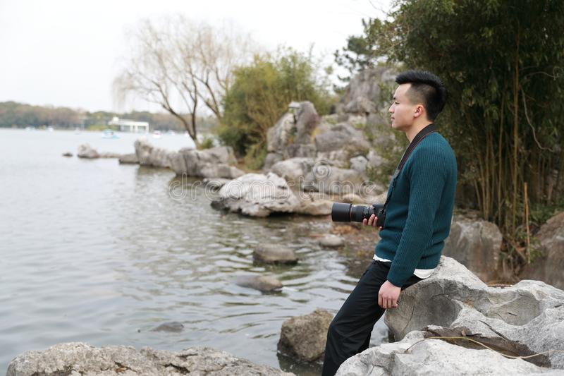 Asian chinese man photographer in park royalty free stock photography