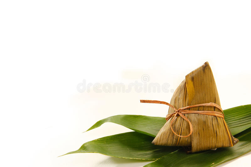 Asian Chinese rice dumplings or zongzi. On wooden background stock photography