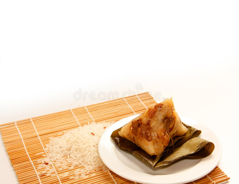 Asian Chinese rice dumplings or zongzi. On wooden background royalty free stock photo