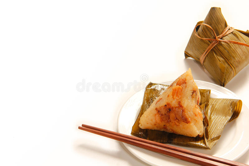 Asian Chinese rice dumplings or zongzi. On wooden background royalty free stock images