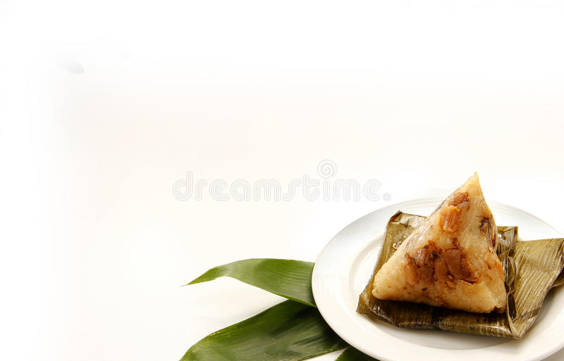Asian Chinese rice dumplings or zongzi. On wooden background stock images