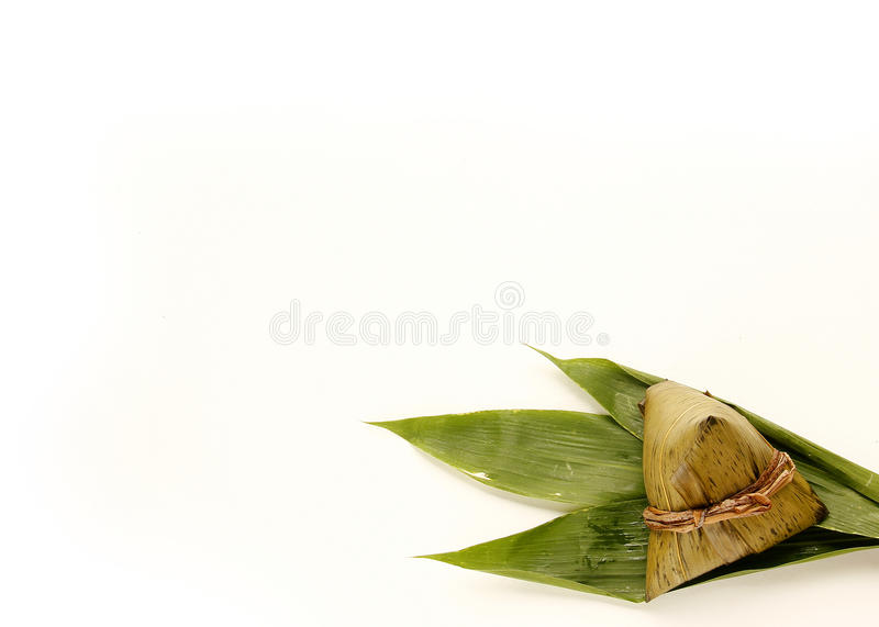 Asian Chinese rice dumplings or zongzi. On wooden background stock photos