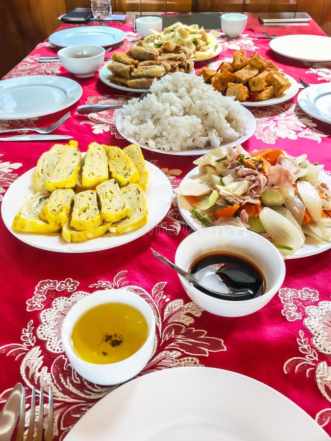 Asian Chinese Seafood Lunch meal banquet on decorative tablecloth. Traditional Asian food, Rice staples with local recipe. Main dishes stock photography