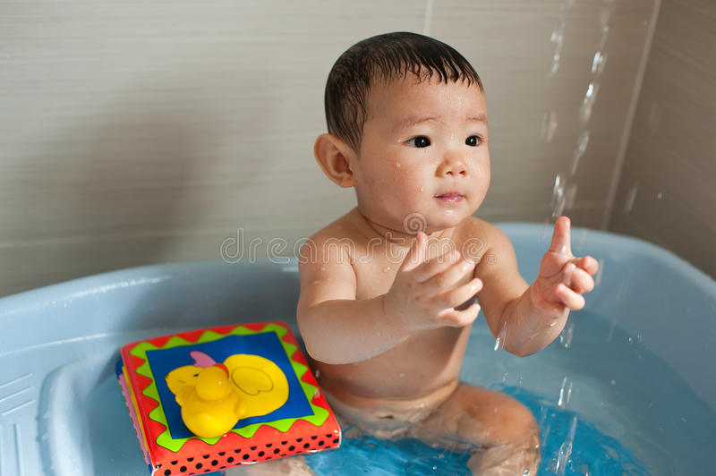 Asian Chinese toddler. Playing in bath tub royalty free stock photography
