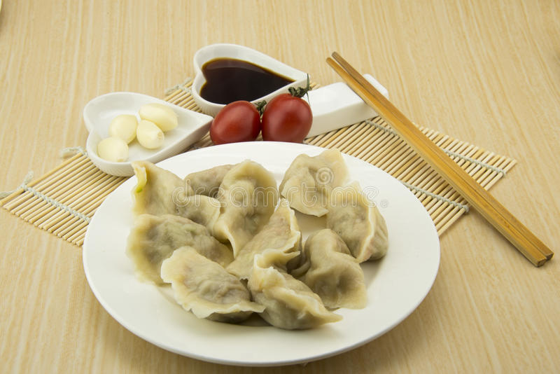 Asian Chinese traditional pasta Boiled dumplings. On the table Chinese Asian traditional pasta, delicious vegetables Boiled dumplings, pork stuffing, delicious stock photography