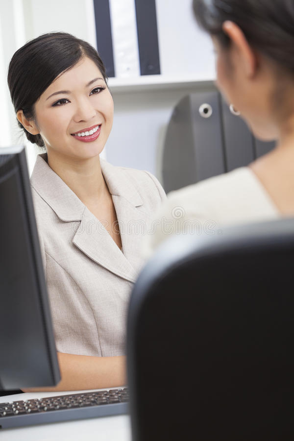Asian Chinese Woman Or Businesswoman In Meeting Royalty Free Stock Photo