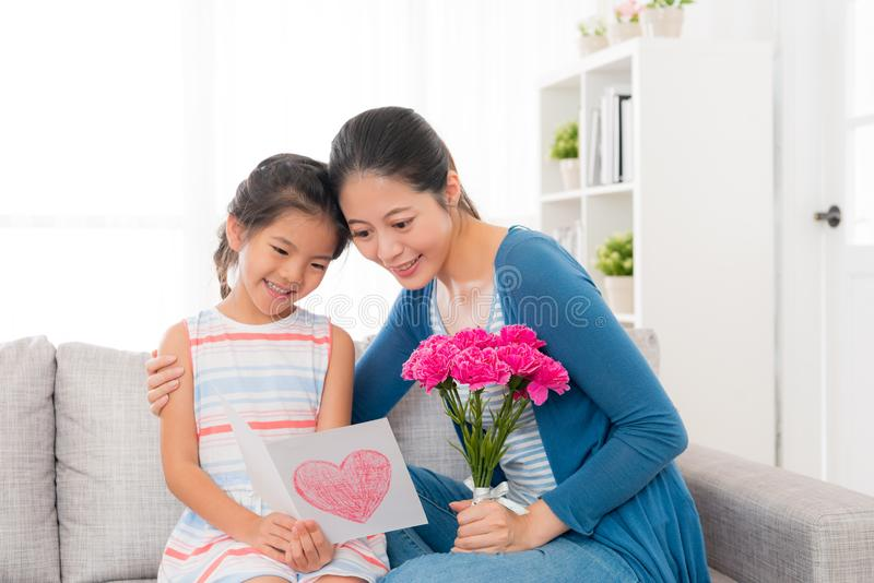 Asian chinese woman holding bouquet with girl stock images