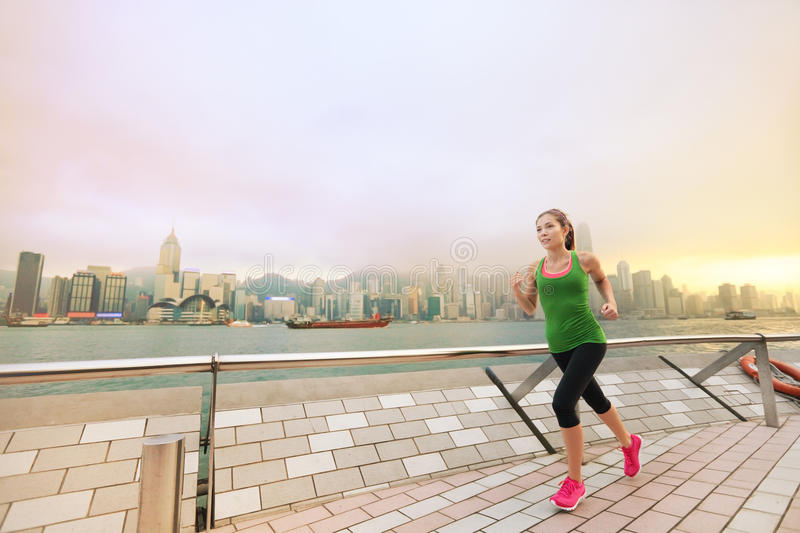 Asian chinese woman runner jogging in Hong Kong. Urban Asian Chinese woman jogging in Hong Kong city. Female fitness athlete running training living healthy stock images