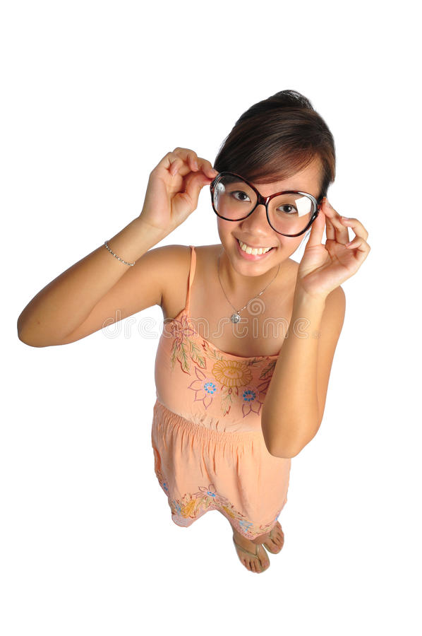 Asian chinese Woman trying to see with glasses. Beautiful young Asian Woman picture taken from the top to give a big doll head effect royalty free stock photos