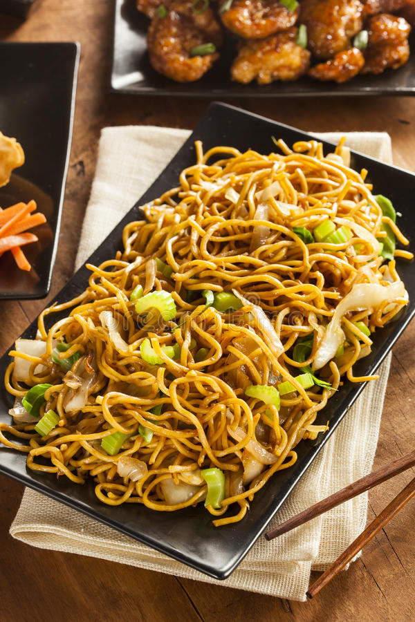 Asian Chow Mein Noodles. With Vegetables and Chopsticks royalty free stock photography