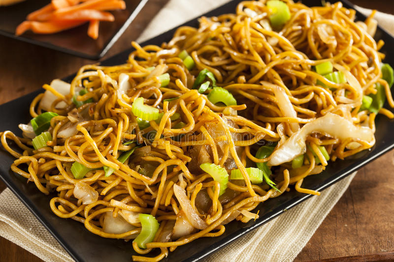 Asian Chow Mein Noodles. With Vegetables and Chopsticks royalty free stock photos