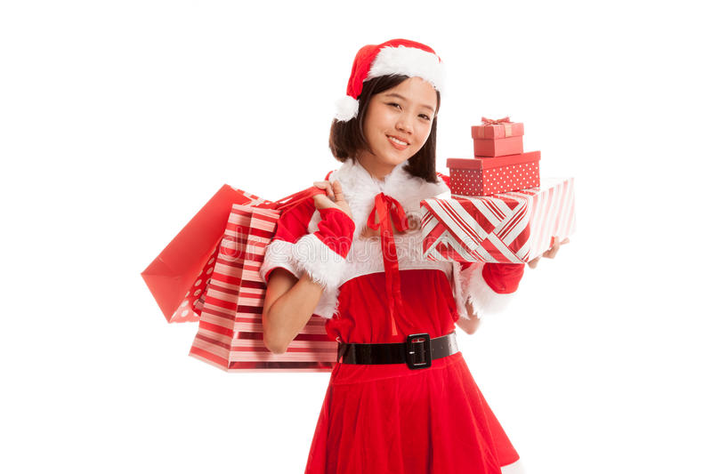 Asian Christmas Santa Claus girl with shopping bags and gift royalty free stock photos