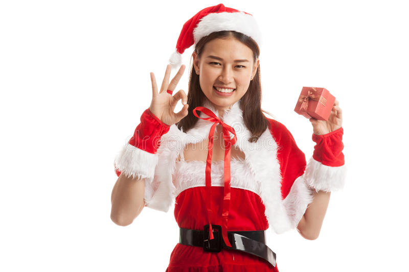 Asian Christmas Santa Claus girl show OK and gift box isolate stock photography