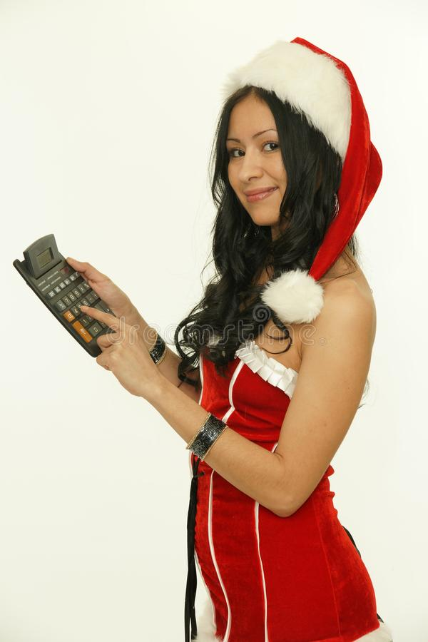 Asian christmas santa woman with calculator royalty free stock images