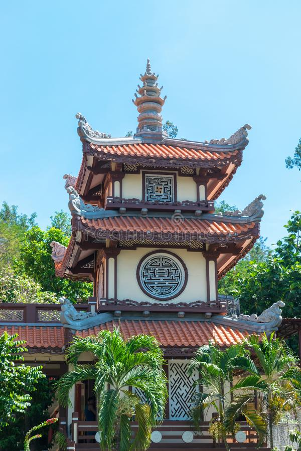 Asian church in Long Son Pagoda in Nha Trang with tropical palms stock photo
