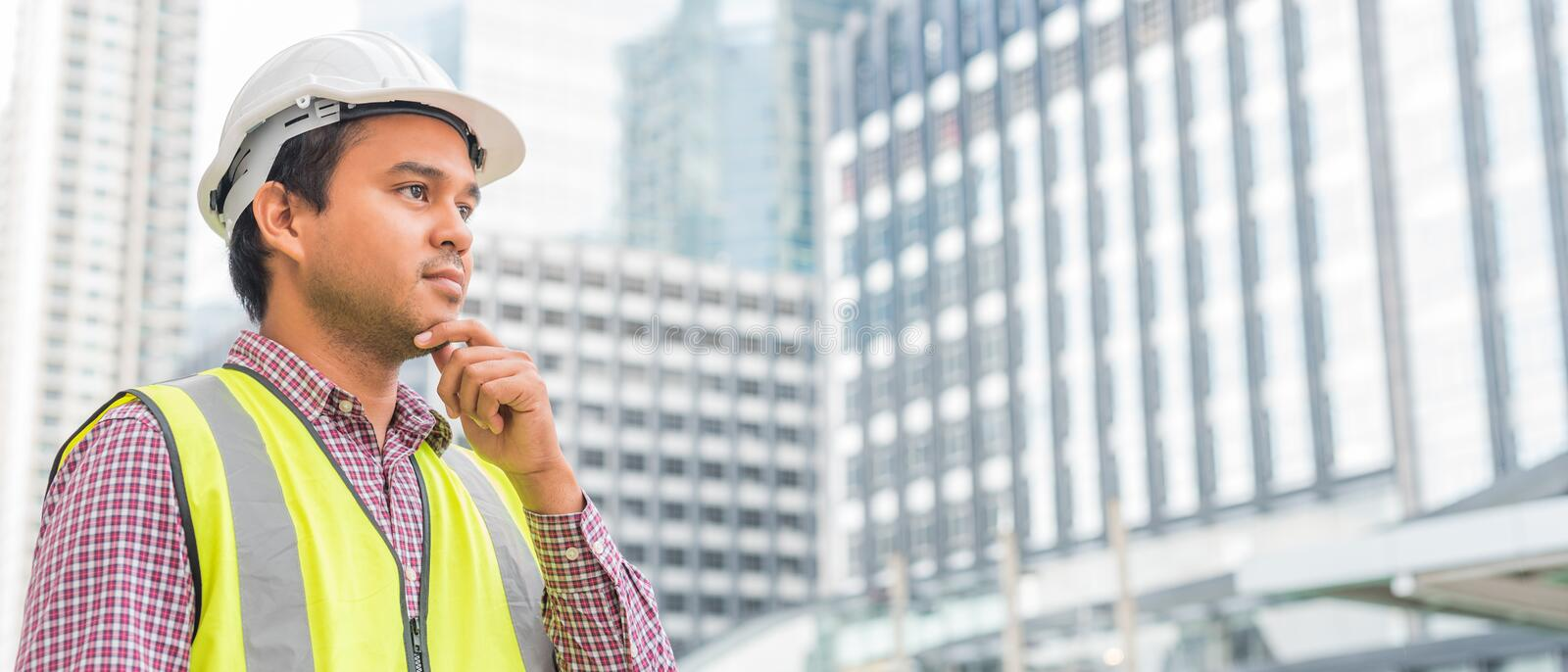 Asian civil engineer working at building site. royalty free stock photography