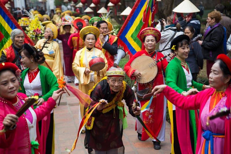Asian civilian artists performing spiritual activities. Hanoi, Vietnam - Jan 27, 2016: Asian civilian artists performing a spiritual dance within a festival to royalty free stock images