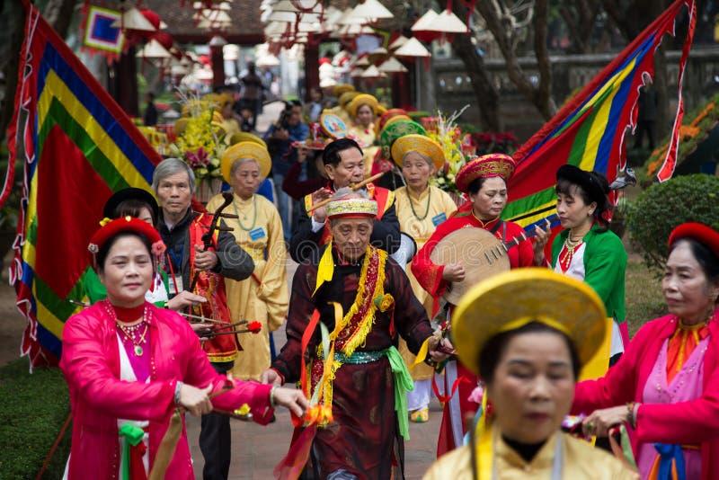 Asian civilian artists performing spiritual activities. Hanoi, Vietnam - Jan 27, 2016: Asian civilian artists performing a spiritual dance within a festival to stock photography