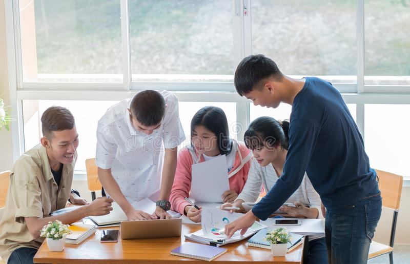 Asian College groups of students using laptop, tablet, studying stock images