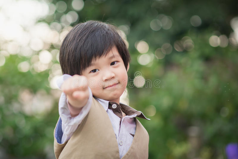 Asian confidence child shows his hand stock photo