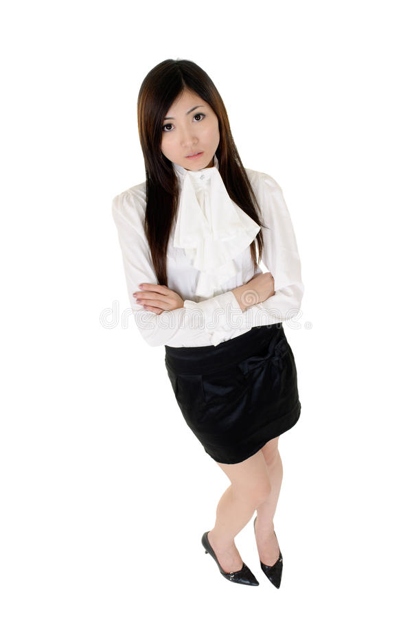 Asian confident business woman. Portrait of Asian confident business woman with smiling dress in white and black dress with her hands crossed stock photos