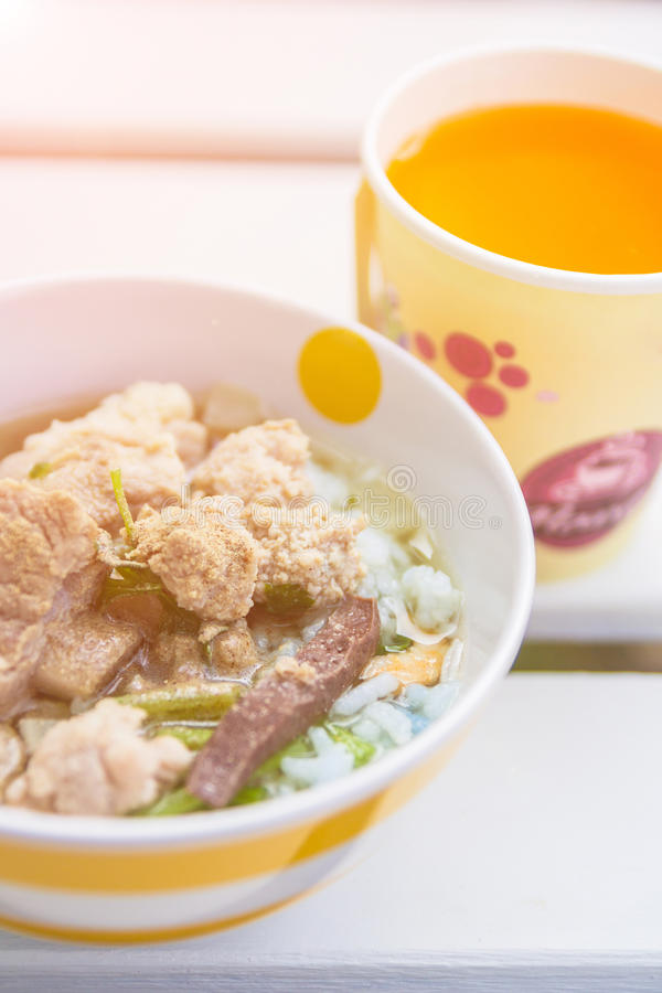 Asian congee with minced pork in bowl stock image