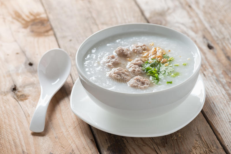 Asian congee with minced pork in white bowl. royalty free stock image