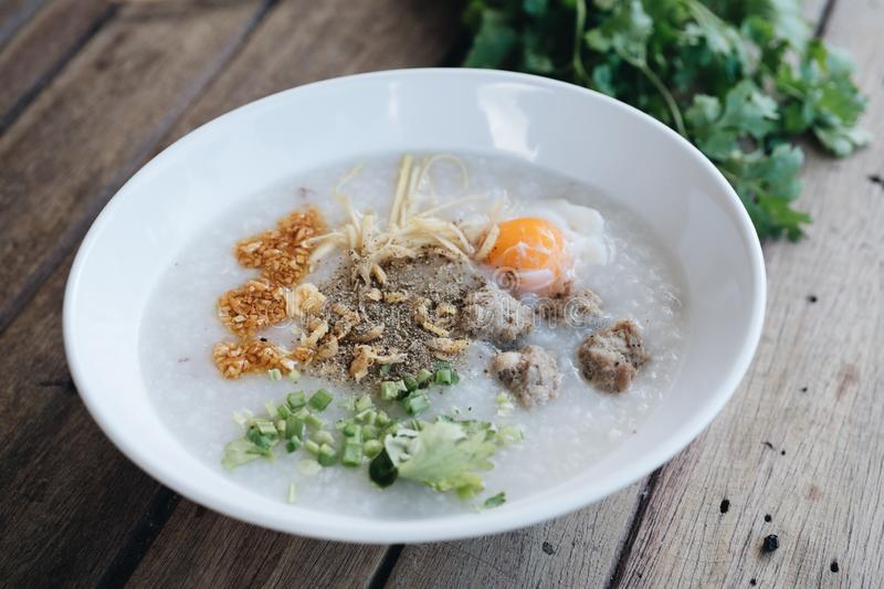 Asian congee with minced pork in white bowl royalty free stock photography