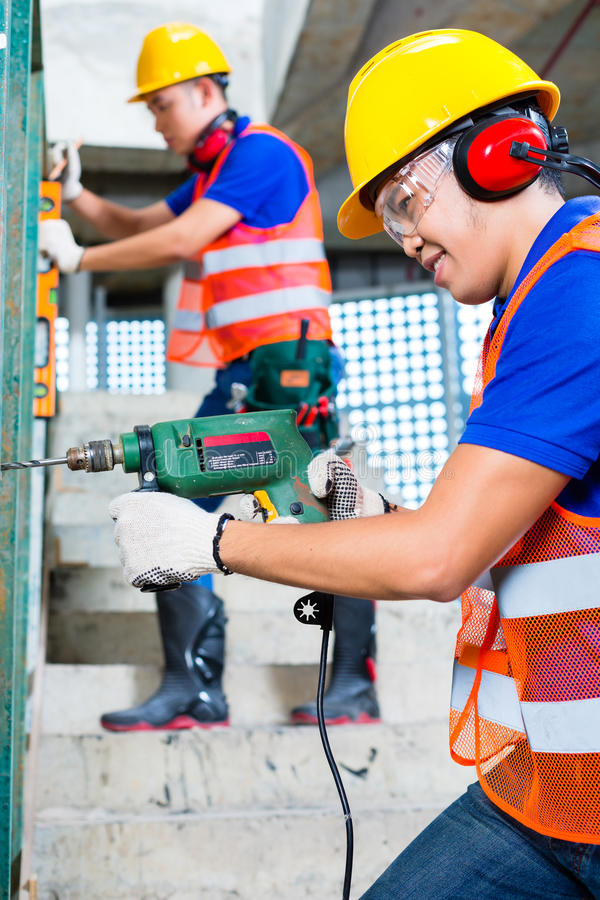 Download Asian Construction Workers Drilling In Building Walls Stock Image - Image of real, drill: 37544495