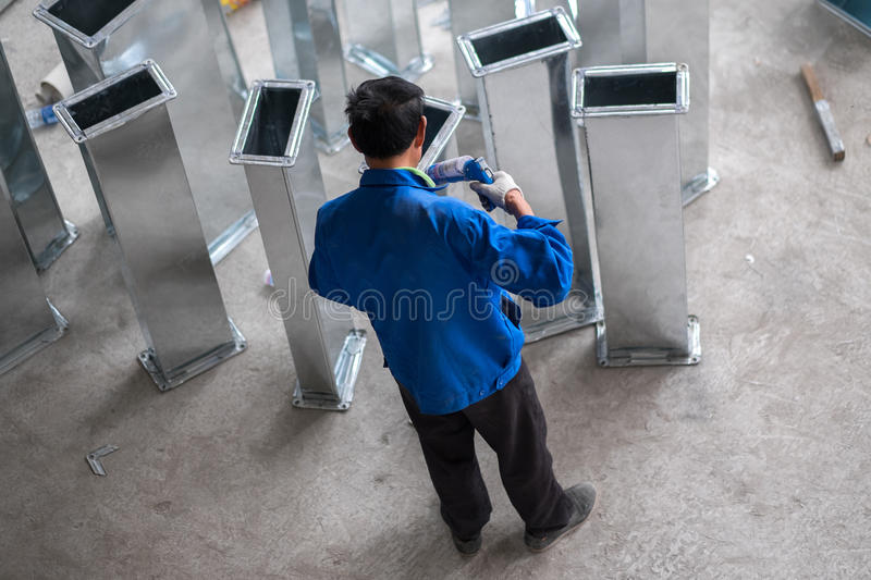 Asian Construction Working Caulking Ducts stock photography