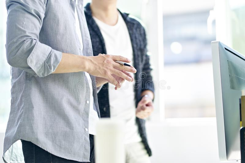 Two corporate people discussing business stock photos