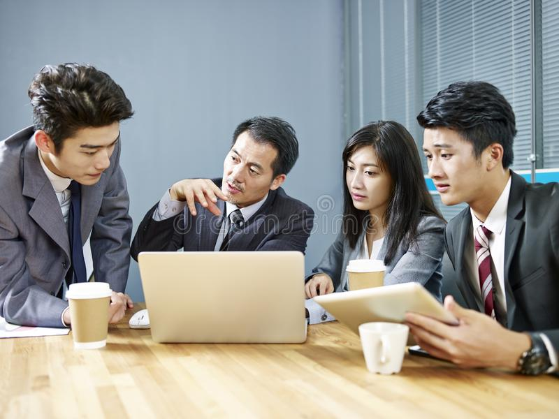 Asian corporate people discussing business in meeting royalty free stock photo