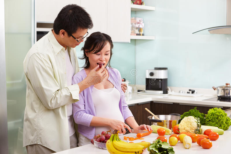 Download Asian Couple Activity In Kitchen Royalty Free Stock Image - Image: 17141766