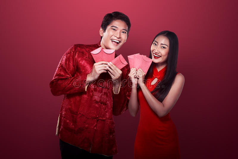 Asian couple in cheongsam suit stock image