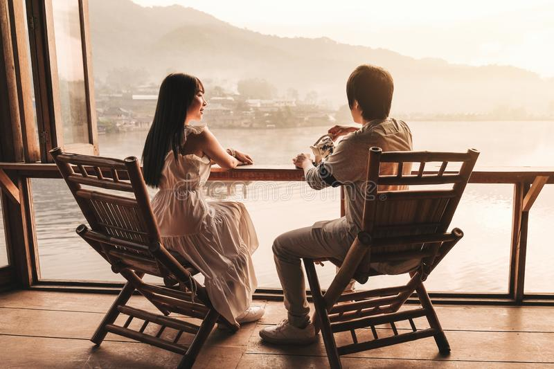 Asian couple drinking Tea Sunrise at Lee wine Rak Thai, Chinese settlement, Mae Hong Son, Thailand stock image