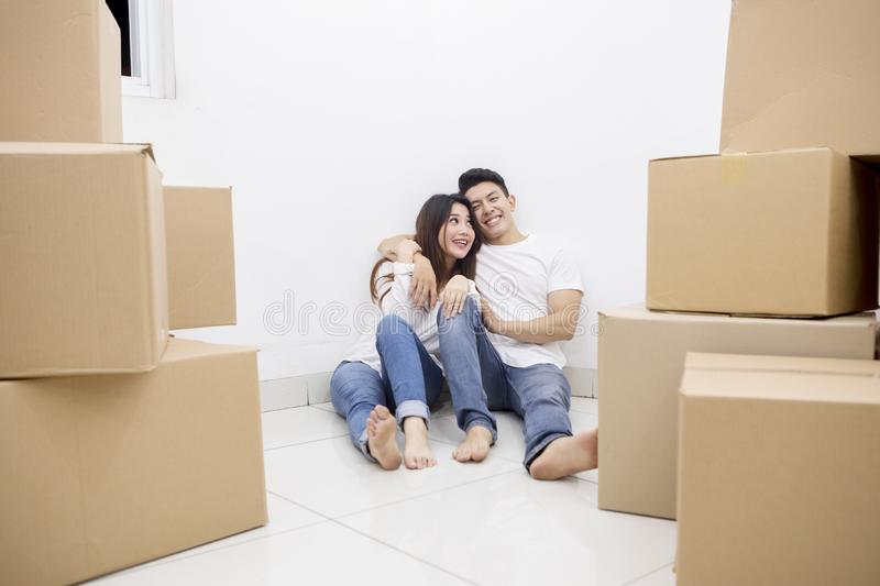 Asian couple enjoying rest time in the new house royalty free stock image