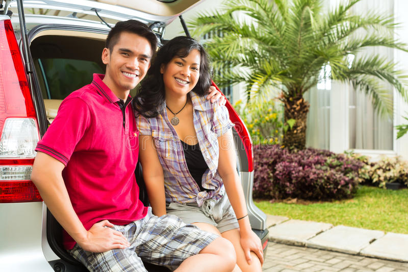 Download Asian Couple Is Happy In Front The Car Stock Image - Image of girlfriend, honeymoon: 28157797