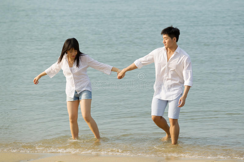 Asian Couple Having Fun At The Beach. Royalty Free Stock Photography