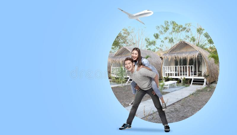 Asian couple having fun with cottage background royalty free stock photography