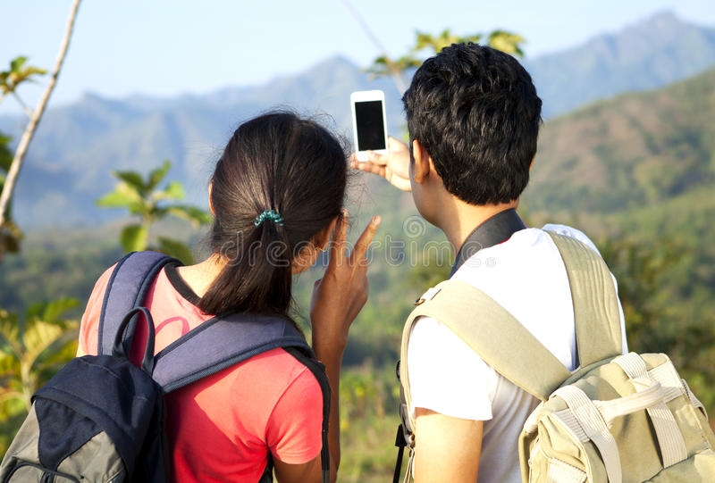 Asian couple hikers stock images