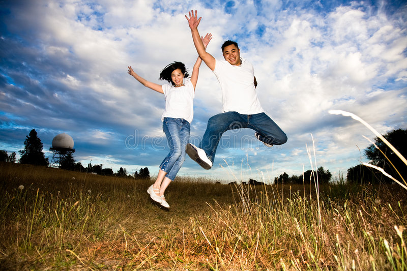 Asian Couple Jumping For Joy Stock Image